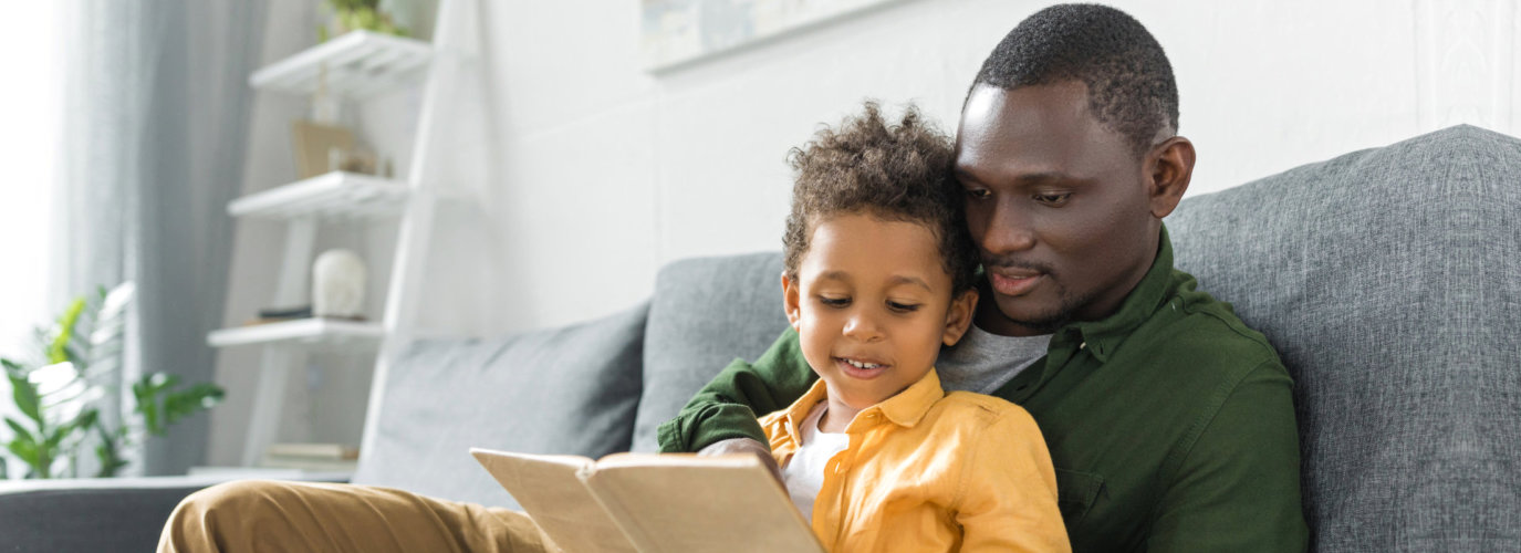 toddler with his father reading